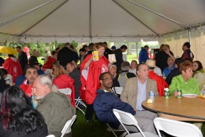 IAM members enjoying a picnic under the tent. IAM, OPCM President- Kim Valliere delivering pop corn with a smile.