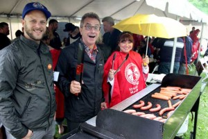 The pouring rain did not stop the IAM members from enjoying a BBQ in the park. Pictured here, we have IAM Local Lodge 2323 member Dan Jansen, IAM Canadian Airline Coordinator Carlos DaCosta and Executive Secretary Jocelyne Collett.