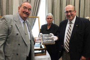 IAM Canadian GVP Dave Ritchie, Stratford Perth Museum Curator Micaela Fitzsimmons and IAM International President Tom Buffenbarger don white gloves to handle the first minutes book- circa 1890 - from the first Canadian Local Lodge 103.